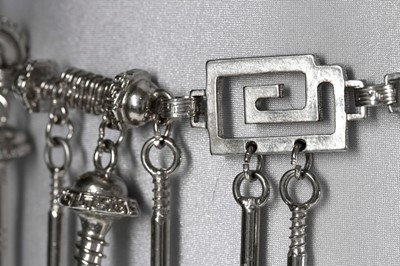 Lot 214 - A Versace 'Nuts and Bolts' metal chain belt,...