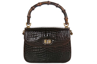 Lot 7-A fine and rare Gucci brown crocodile handbag with bamboo handle, 1960s