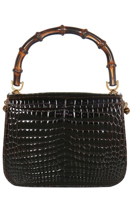 Lot 7 - A fine and rare Gucci brown crocodile handbag with bamboo handle, 1960s