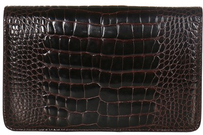Lot 10 - A Gucci brown crocodile clutch bag with bamboo lift-clasp, early 1970s