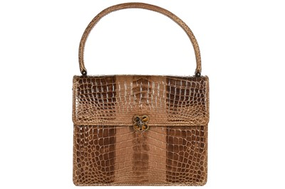 Lot 9-A Gucci crocodile handbag, 1960s