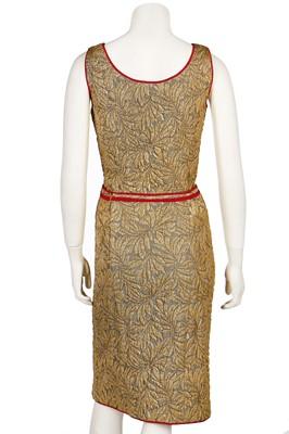 Lot 20 - A Chanel couture gold brocatelle cocktail ensemble gold suit, 1962