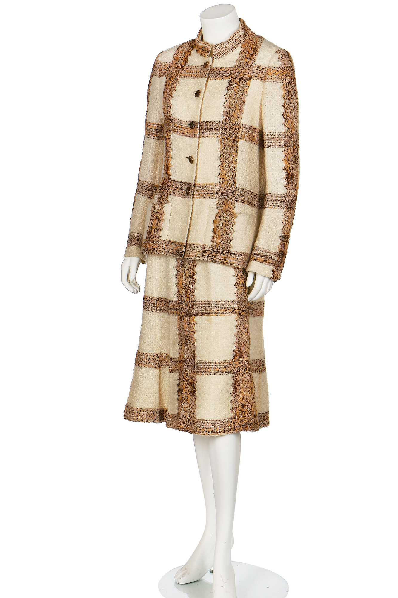 Lot 15 - A Chanel couture oatmeal and ivory tweed suit, 1969