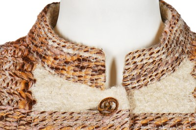 Lot 15-A Chanel couture oatmeal and ivory tweed suit, 1969