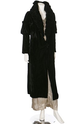 Lot 30-A black velvet evening coat with Chinese embroidered skirt panel to lining, 1930