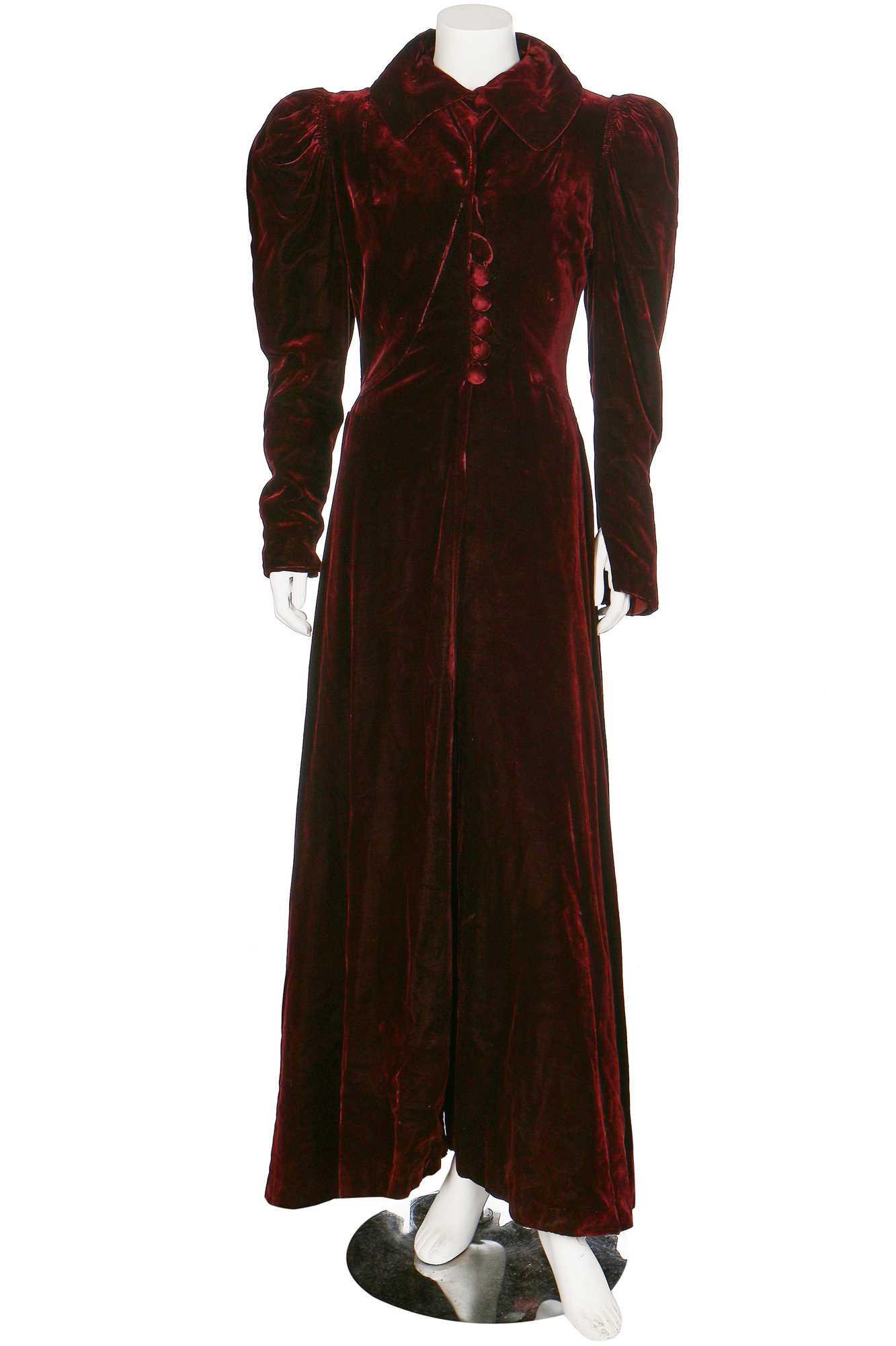 Lot 43-A bordeaux velvet evening coat with leg-o-mutton sleeves, 1930s