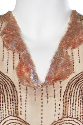 Lot 47-A lamé evening gown in shades of pink, silver and blue, mid-1920s, altered in the 1930s