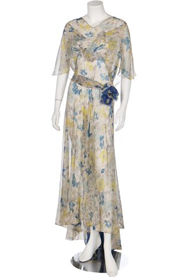 Lot 54-A good floral printed chiffon garden-party gown in shades of blue and yellow, 1930s