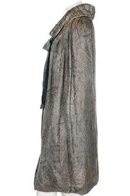 Lot 21-A lamé evening cloak in shades of blue and gold, 1920s