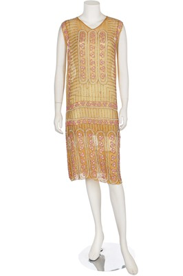 Lot 5-A beaded mustard muslin flapper dress, mid-1920s