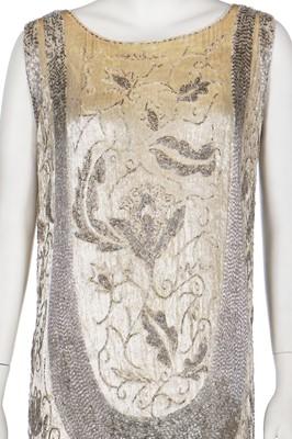 Lot 19-Two ivory beaded flapper dresses, 1920s
