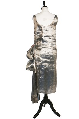 Lot 7-A blue lamé dress with draped swags and cascading iridescent-pink petals to hip, 1920s