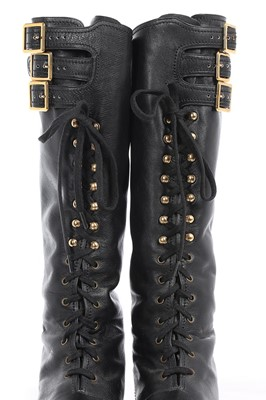 Lot 7 - A rare pair of Chanel leather 'combat' boots,...