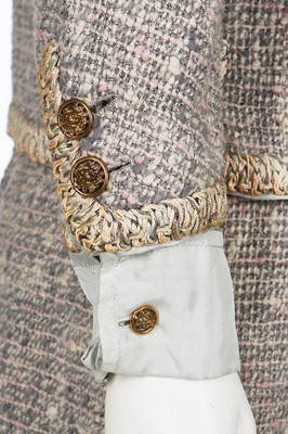 Lot 17 - A Chanel couture grey-pink tweed suit, 1960