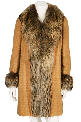 Lot 16-A Chanel couture yellow bouclé wool and fox fur coat, mid 1970s