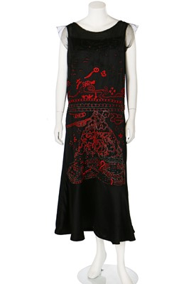 Lot 73-A beaded dress in the style of Jean Patou's 'Nuit de Chine', Italian, circa 1922 but later altered