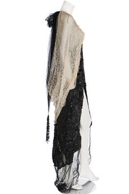 Lot 32 - A kimono-style coat of Poiret-inspired printed silk, edged in black fur, circa 1918