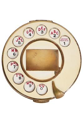 Lot 86-A rare Salvador Dali for Schiaparelli 'Telephone Dial' compact, 1935