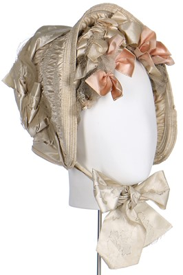 Lot 39-An  ivory silk bonnet and bridal headdress, circa 1845
