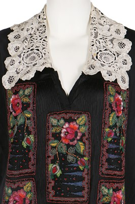 Lot 40 - A knitted silk jersey blouse with appliqued embellished panels, 1920s