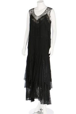 Lot 57 - A black chiffon evening dress with lace insertions, circa 1930