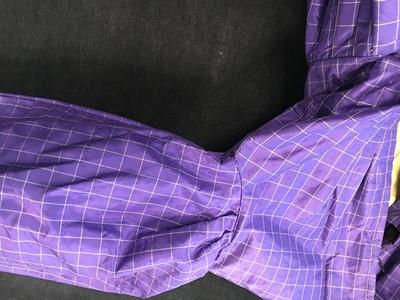Lot 4 - A gown of violet Mauveine taffeta, 1850s