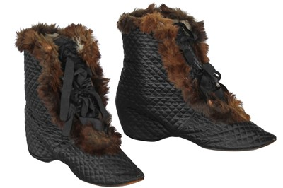 Lot 16 - A pair of black quilted satin carriage boots, 19th century
