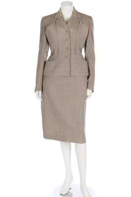 Lot 84 - A Schiaparelli flecked beige wool suit, circa 1950