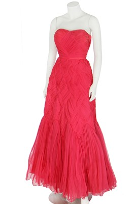 Lot 94 - A raspberry-pink pleated chiffon evening gown in the style of Jean Dessès, circa 1959