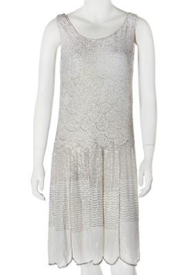 Lot 50 - A white muslin beaded flapper dress, circa 1928