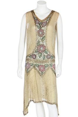 Lot 48 - A beaded pale yellow muslin flapper dress, circa 1925