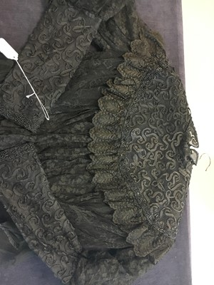Lot 9 - A group of mainly black clothing, 1890s-circa 1900