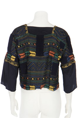 Lot 35 - A quilted silk jacket with Ottoman-inspired embroidery, 1920s