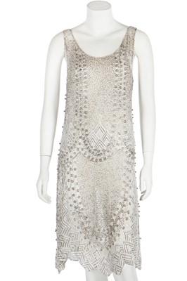 Lot 51 - A beaded white muslin flapper dress, circa 1928