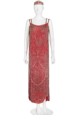 Lot 52 - A coral-pink silk beaded flapper dress, late 1920s