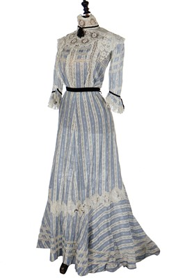 Lot 19 - A floral printed blue and white striped cotton gown, circa 1905