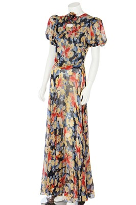 Lot 65 - A good floral printed chiffon garden party gown, 1930s