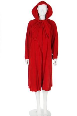 Lot 91 - A Schiaparelli red velvet swing-coat with hood, late 1950s