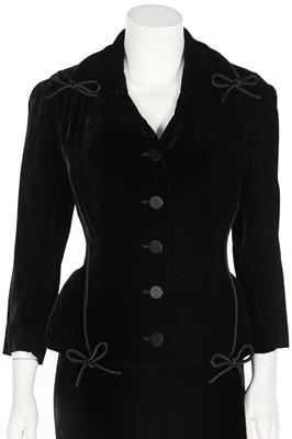 Lot 90 - A Balmain black silk-velvet suit, 1956