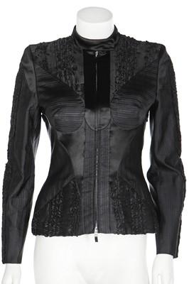 Lot 49 - An Alexander McQueen black silk patchwork jacket, circa 2003