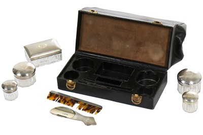 Lot 31 - A Cartier dressing case, the silver fittings 1912