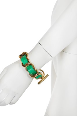 Lot 23 - A Chanel chunky gilt chain and woven green leather bracelet, 1987