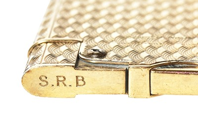 Lot 32 - A Cartier brushed-gold plated lighter, mid-20th century