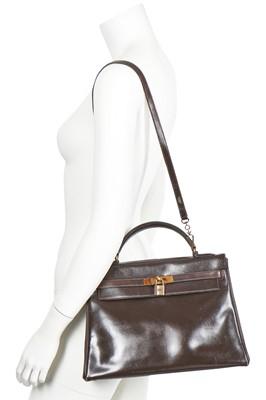 Lot 34 - An Hermès brown box leather Kelly 32, 1970