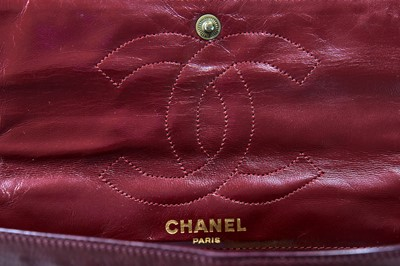 Lot 2 - A Chanel bordeaux-red quilted lambskin leather flap bag, 1980s