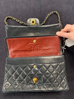 Lot 8 - A Chanel navy quilted lambskin leather flap bag, 1980s