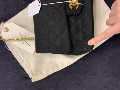 Lot 4 - A Chanel black quilted wool-jersey flap bag, 1989-91