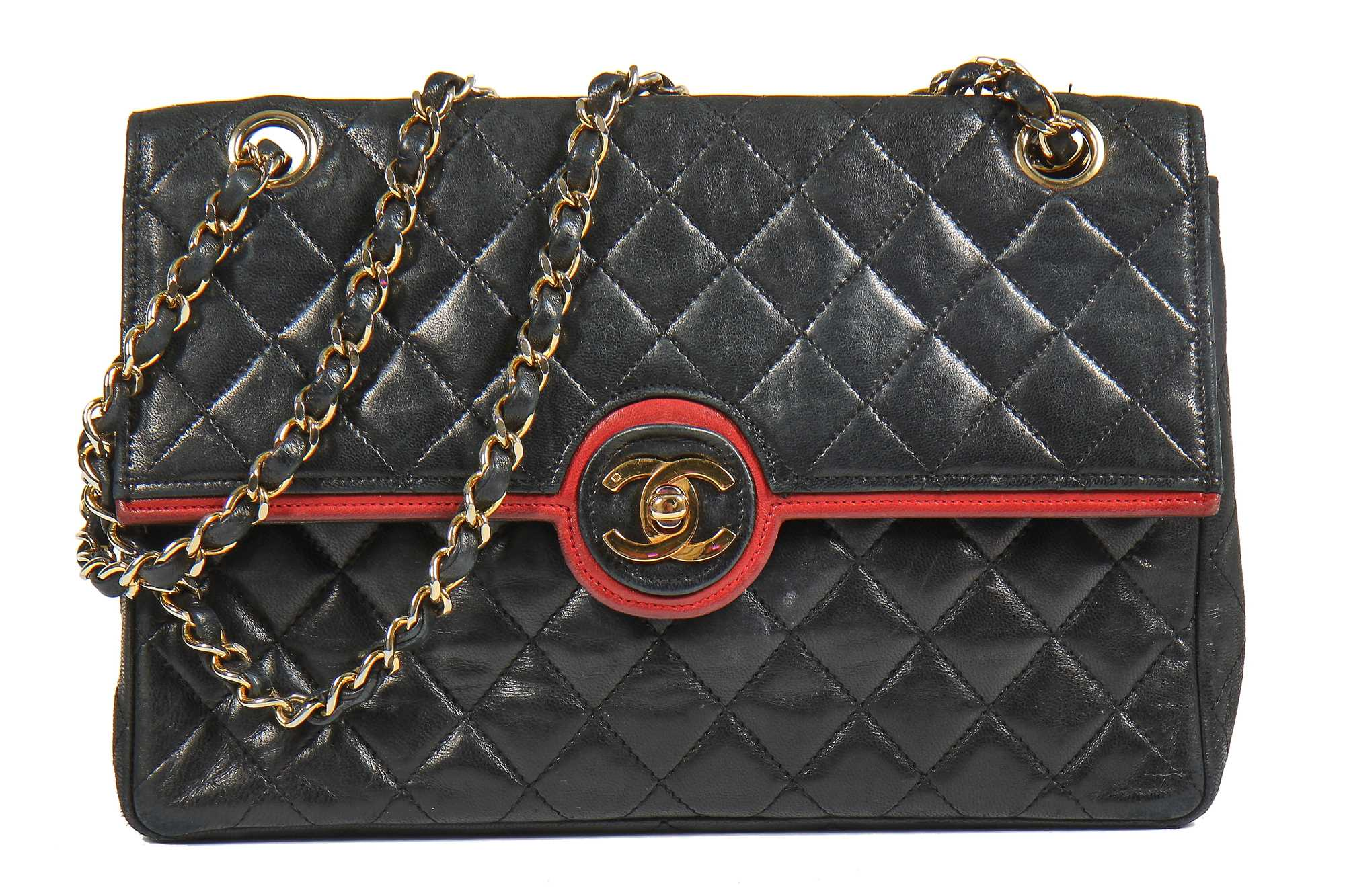 Lot 6 - A Chanel black quilted lambskin leather flap bag, 1980s
