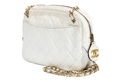 Lot 12 - Three Chanel quilted lambskin leather handbags in shades of white, 1980s