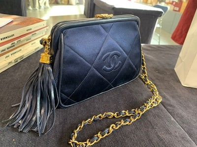 Lot 5 - A Chanel quilted midnight-blue satin evening bag, 1980s